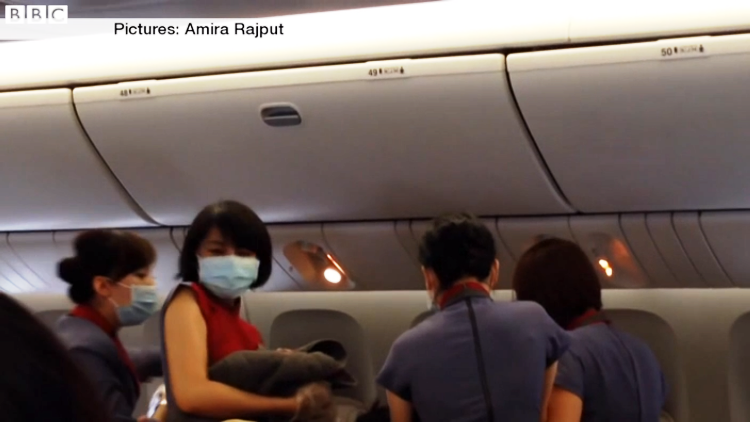 Video Woman delivers baby on flight and cheering follows