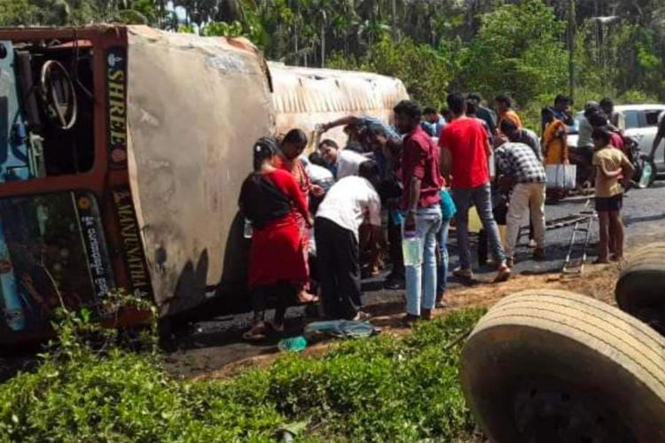 Tanker toppled on road people near it