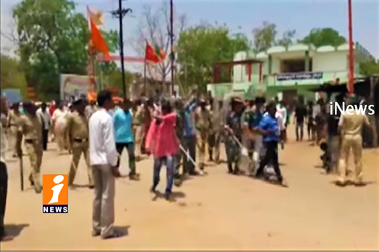 Communal violence in Telangana Police lob teargas shells as mob pelts stones in Utnoor
