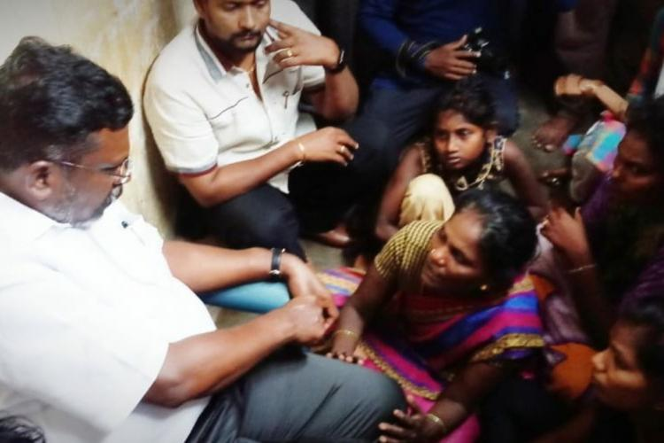 VCK founder Thol Thirumavalavan with the family members of the deceased Suriya