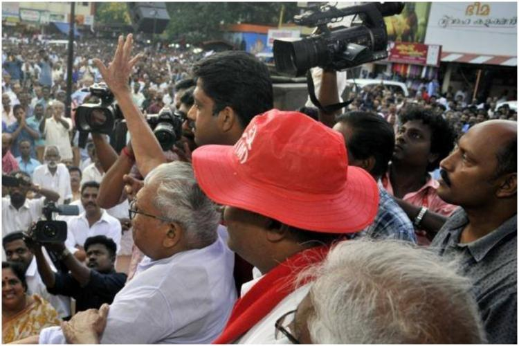 CPI (M) leader VS Achuthanandan waving at a mass meeting