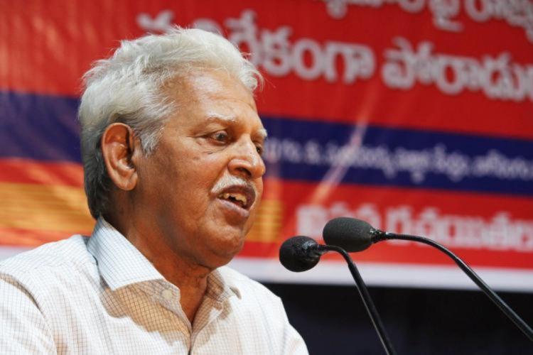 Poet and political activist Varavara Rao speaking into a mic
