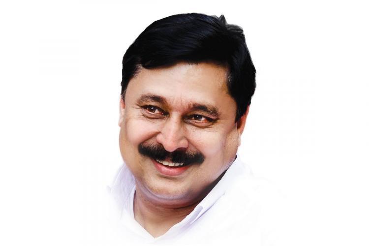 Abdurahiman wearing a white shirt smiles