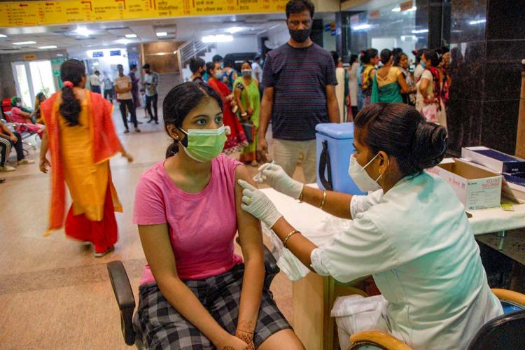 Woman getting vaccinated