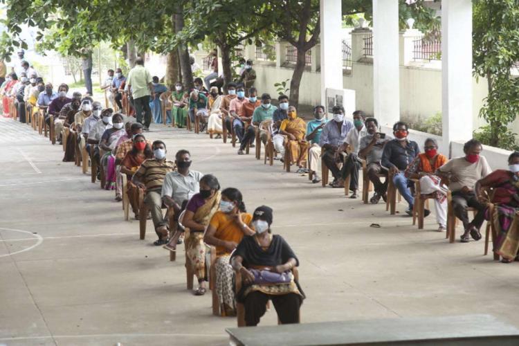 Beneficiaries wait to receive the COVID-19 vaccine dose at a vaccination camp at Vetoornimadam Saint Alozhious school in Kanyakumari Saturday May 29 2021