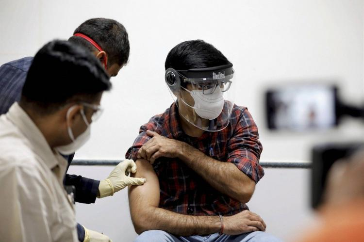 A man getting a vaccine shot