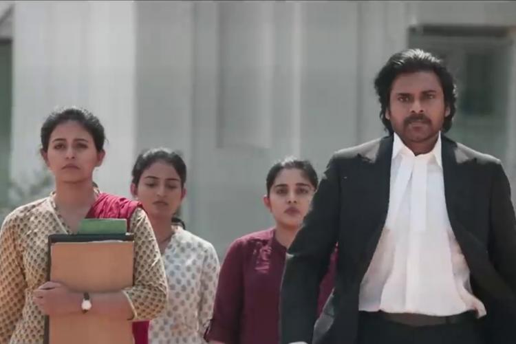 Pawan Kalyan dressed as an advocate Nivetha Thomas Ananya Nagalla Anjali walking behind him