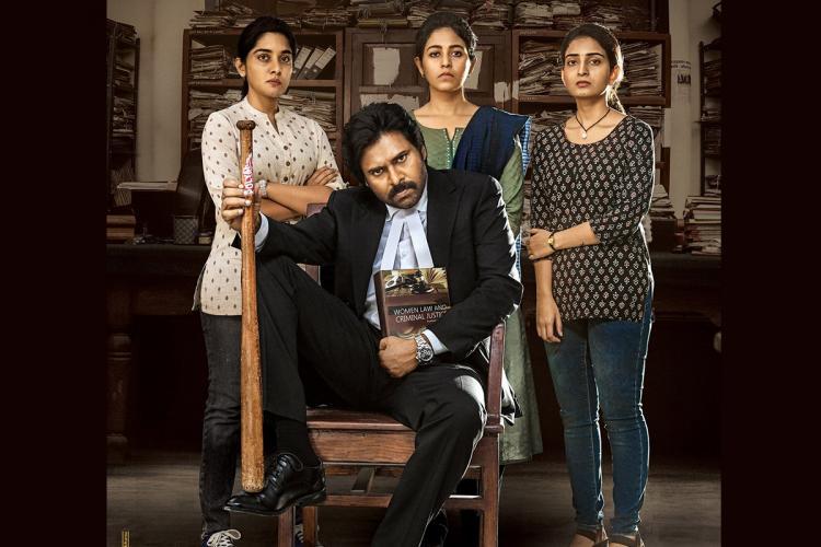 Vakeel Saab Poster with Pawan Kalyan sitting in a chair, Nivetha Thomas, Anjali and Ananya Nagalla standing behind him