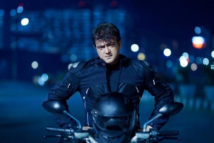 Ajith sitting on his bike