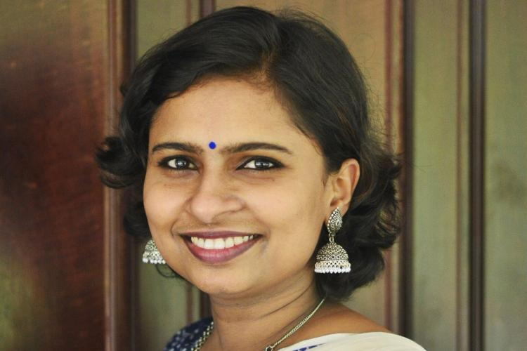 Vani with her short hair and jhumka earings, smiles