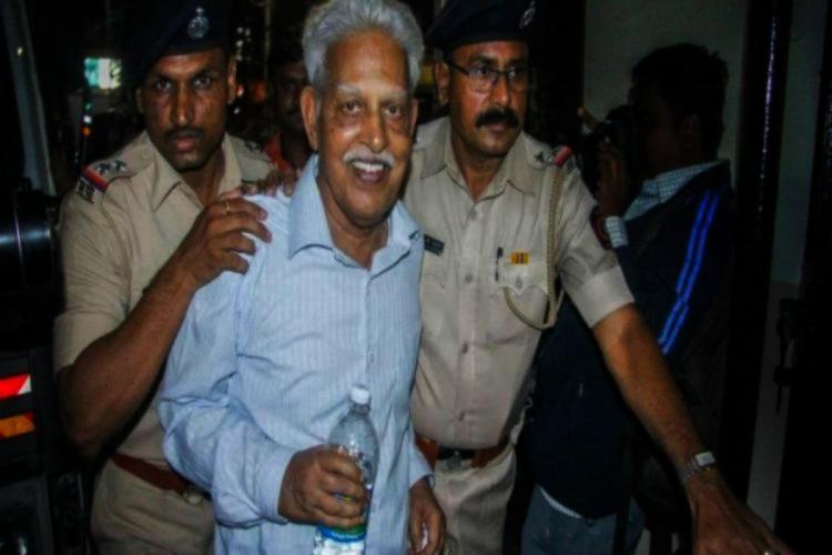 Varavara Rao being accompanied by cops