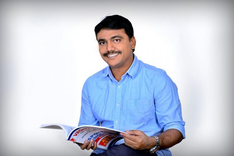 Vashishta Bhragav with his Spoken English Course book