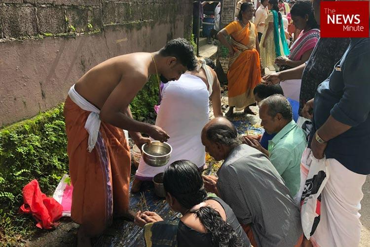 Kerala rains As temple remains submerged in Aluva devotees offer Bali on roads