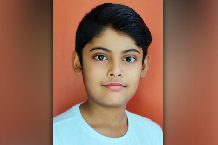 A close-up photo of 10-year-old Veer Kashyap who developed the board game Corona Yuga