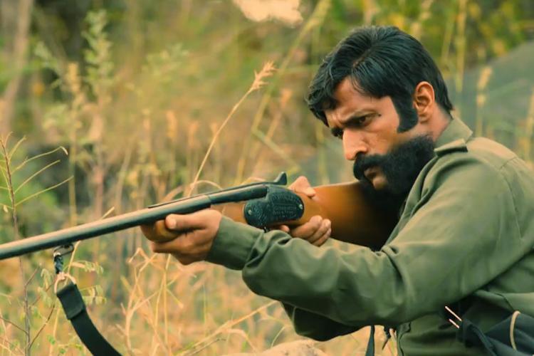 Still of man holding gun Veerappan
