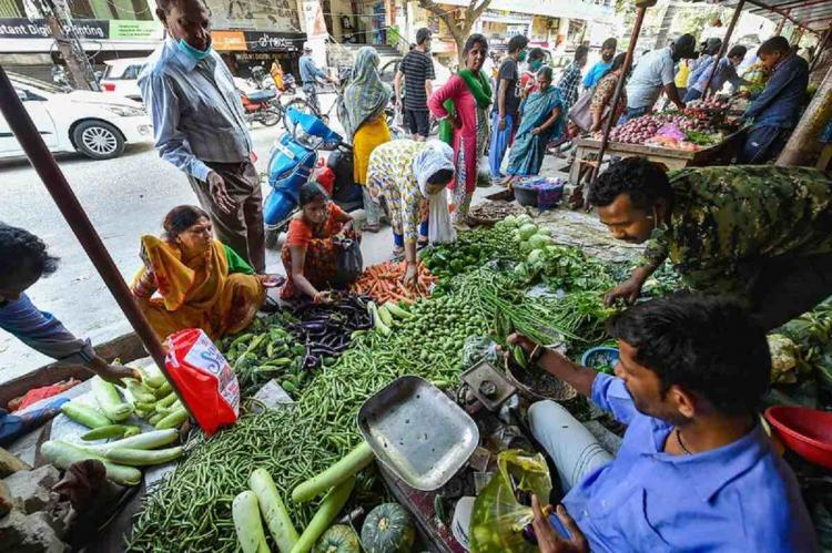 inflation eases to 693 pc in November as food prices soften