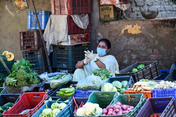 A file photo of a vegetable seller amid the coronavirus pandemic in India