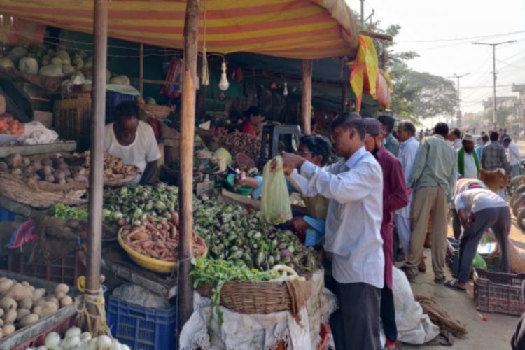 Man buying vegetables at a vegetable market