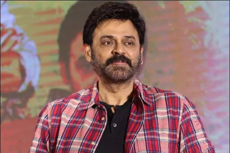 Venkatesh in a black t shirt and chequered maroon shirt