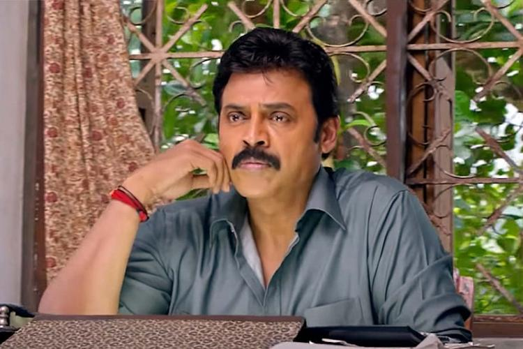 Venkatesh in a blue grey shirt looking worried in Drushyam
