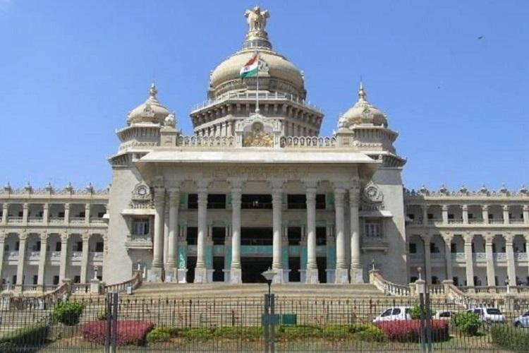 Karnataka Ministers staffer caught with Rs 14 lakh cash BJP calls for resignation