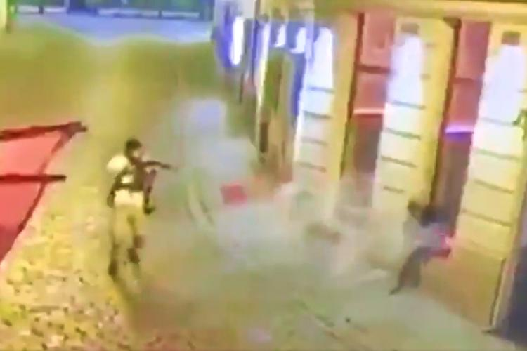 A screengrab of a video of the Vienna attacker, seen pointing a gun, as shared by users on social media