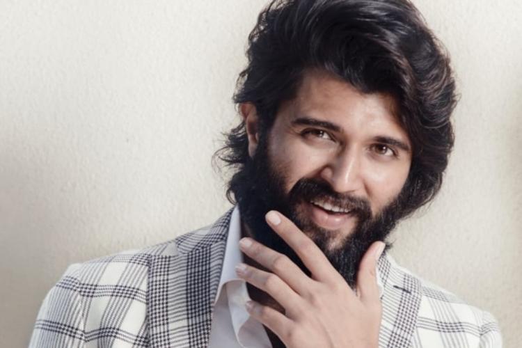 File photo of Vijay Devarakonda looking into a camera wearing a striped jacket in grey