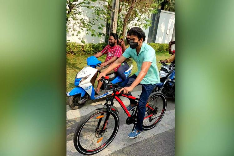 Vijay riding bicycle to vote
