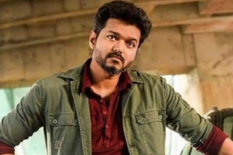 Actor Vijay from Sarkar in maroon shirt and khaki jacket