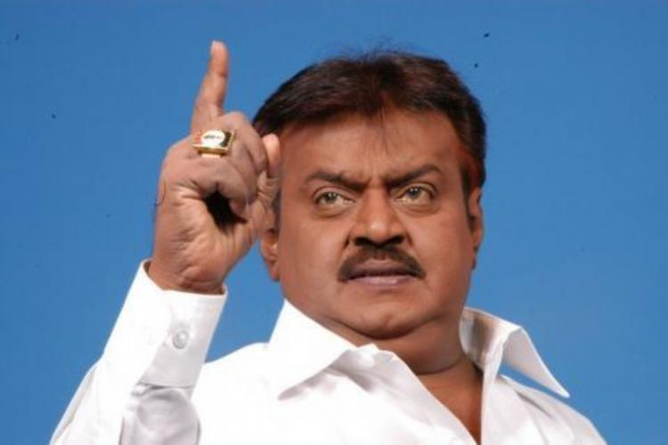 DMDK founderVijayakant posing with his finger stretched out threateningly