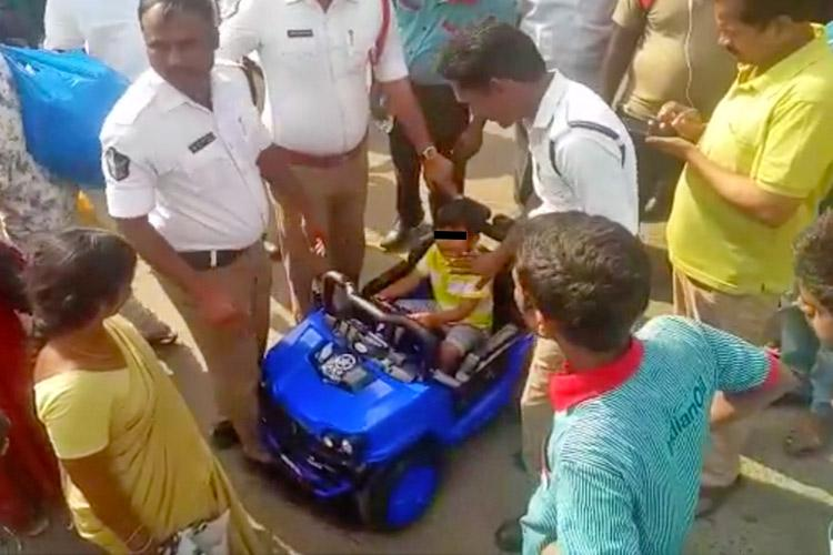 5-yr-old drives toy car into busy Vijayawada traffic rescued before any mishap