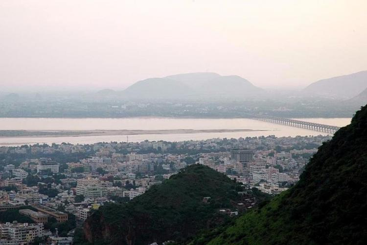 View of Vijayawada from gandhi hill with buildings hills and prakasam barrage on krishna river visible