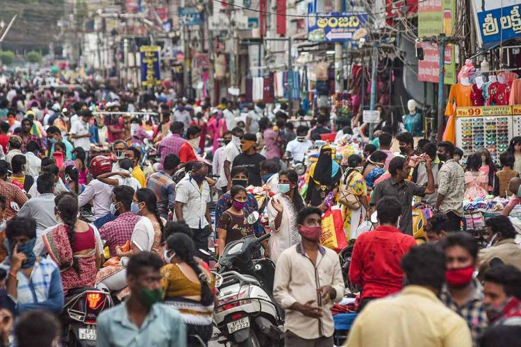 Crowded Besant Road in Vijayawada filled with people wearing masks