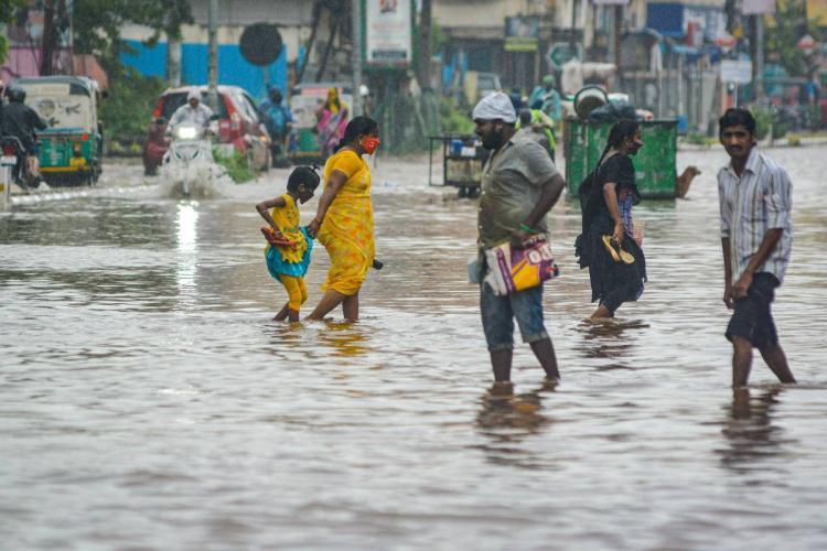 People wading through inundated roads in Vijayawada