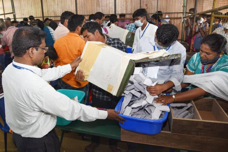 Officials counting municipal election votes at Loyola college in Vijayawada