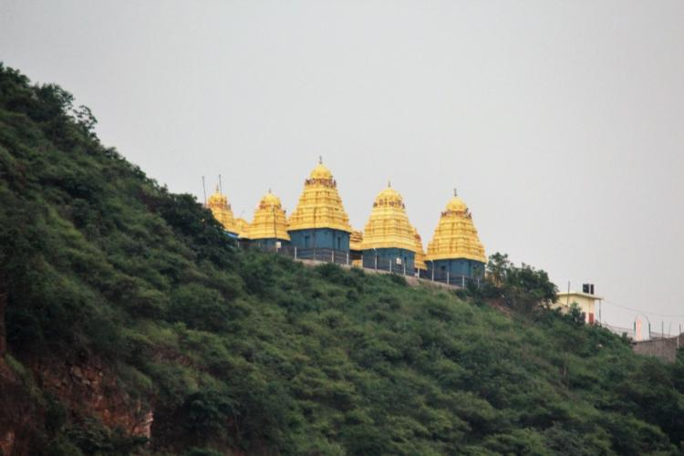 View of the Kanaka Durga temple in Vijayawada from a distance with the hills and temple top visible
