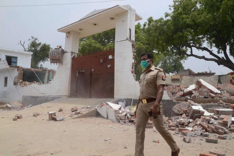 Debris lie on the ground following the demolition of the residence of criminal Vikay Dubey