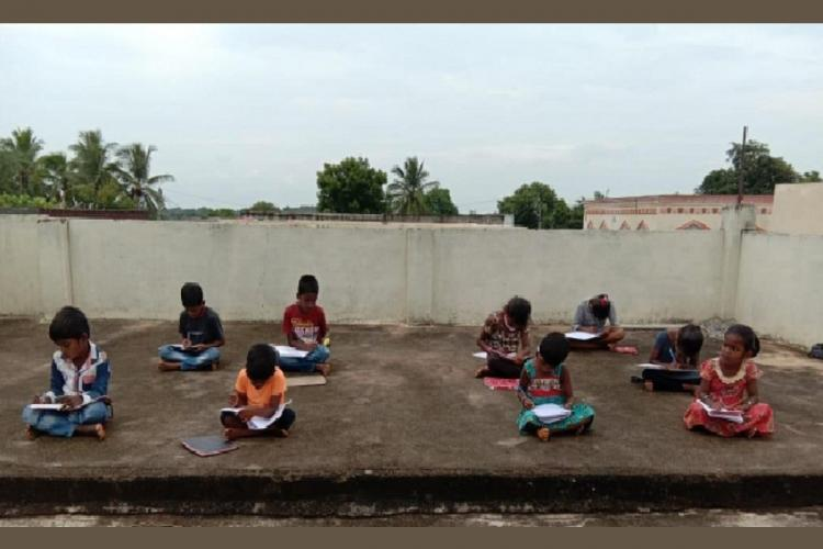A village learning circle in Telangana amid the coronavirus crisis Several students are seen busy studying sitting a few feet apart from each other