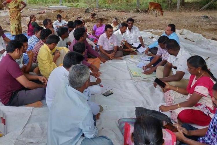 Office bearers of village panchayat and villagers at a panchayat meeting