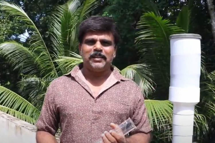 Kerala Man Vinod in Alappuzha who has set up a rain gauge at his home.