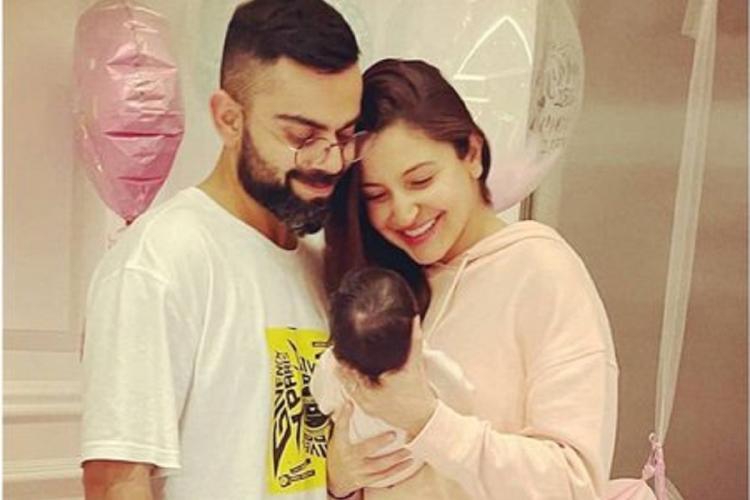Anushka Sharma holding her and Virat Kohli's newborn daughter, Vamika, with Virat beside her