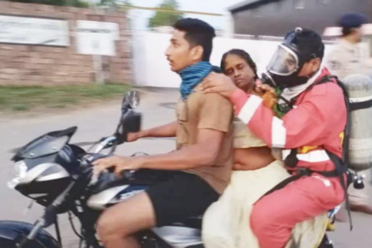 A woman being shifted to hospital on a bike in Vishakapatanam after gas leakage