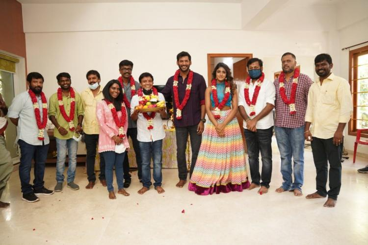 Vishal and Dimple Hayathi are seen along with the rest of the crew in the image taken during the pooja of Vishal 31