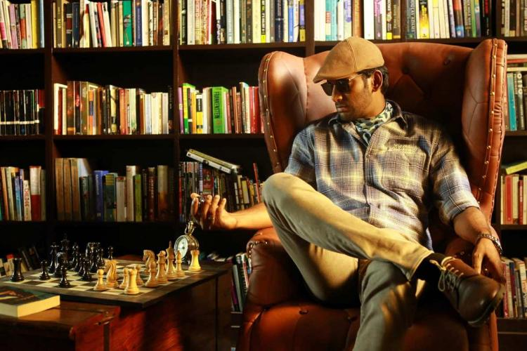 Vishal from a scene in Thupparivaalan playing chess