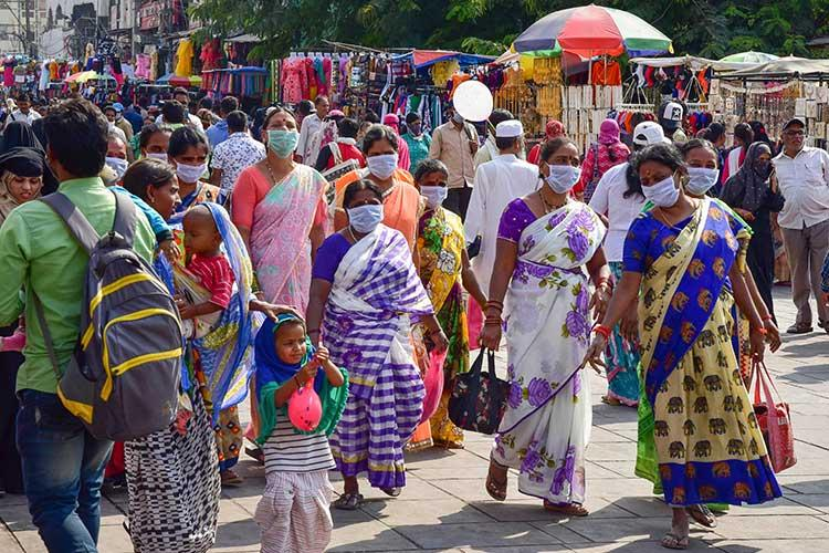 Will Indias warm humid weather contain the coronavirus spread Its too early to say