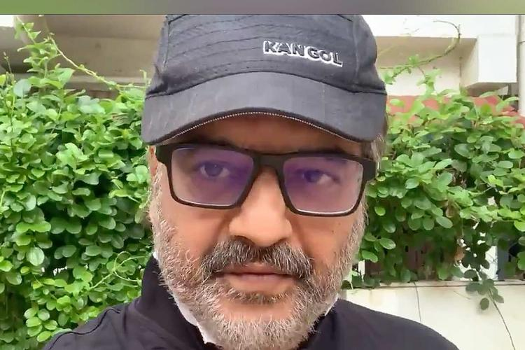 Actor Vivek with glasses and cap
