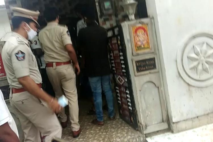 Police entering the house of the six murder victims in Vizag