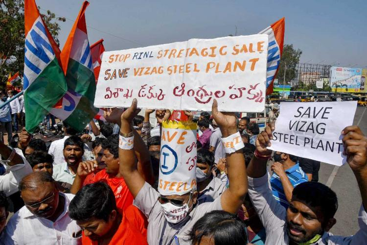 Vizag Steel Plant employees and trade union members stage a protest against the central governments decision of privatization of the Rashtriya Ispat Nigam Limited RINL