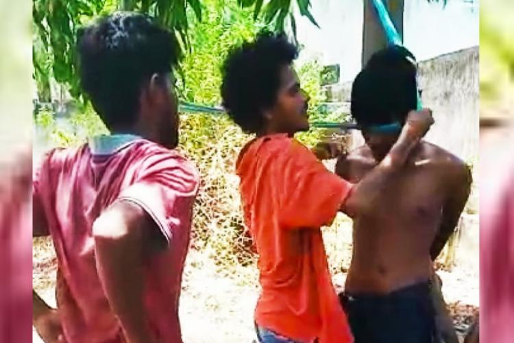 A man being tied up and thrashed in Visakhapatnam in Andhra Pradesh