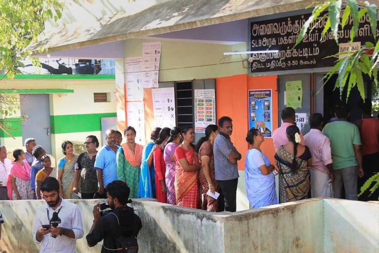 Tamil Nadu voters standing in line in front of the polling station during Lok Sabha elections 2019